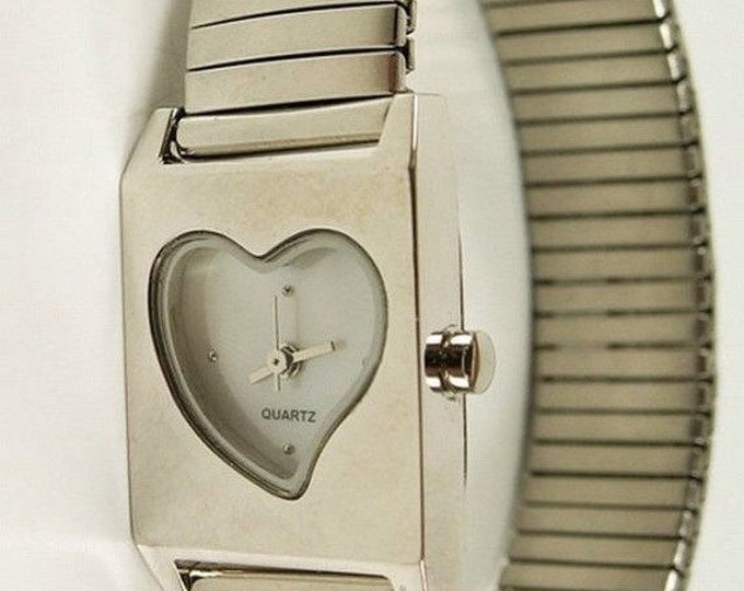 Storewide 25% Off SALE Vintage Ladies Heart Shaped Open Watch Face Designer Timepiece Featuring a Flexible Silver Tone Stretch Band