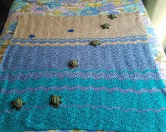 "Crochet sea turtle blanket.36"" by 42"" or you have the option to order a  couch throw with hand stitched sea turtles and two star fish."