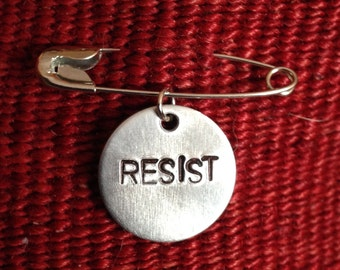 Safety pin with simple RESIST bangle/charm/pendant