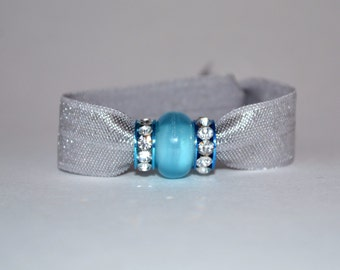 Elastic hair tie in silver with 3 blue charms. No crease hair ties, yoga hair ties, charm bracelet, beaded hair ties, stocking stuffer