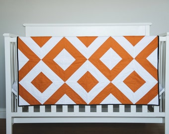 "Modern Baby Quilt. Bold Rust and White, Graphic Geometric Quilt. ""The Austin"" with a Animal Menagerie Backing. Quilted Baby. Baby Boy Quilt."