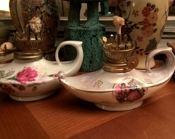 Lot of two vintage porcelain oil lamps