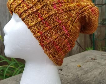 Hand Knit Hat, Ribbed Edge and Twisted Stitch Pattern, Machine Washable Merino Wool, Large Hat, Caramel Tones with pops of Gold and Pink