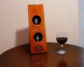 Bluetooth speaker system made from a reclaimed French oak wine barrel. 30 Watts of pure sound!