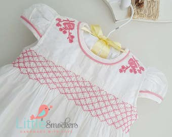 Beautiful white hand smocked and embroidered baby dress
