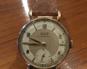 An Art-Deco 14K Rose Gold Tissot gents' watch. Manual. With drop-shaped lugs.