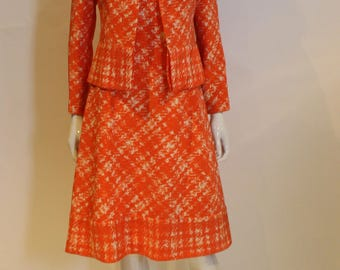 A vintage 1960s Pierre Balmain Couture Orange two piece a matching jacket and dress