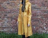 Golden raincoat in a shape of a dress