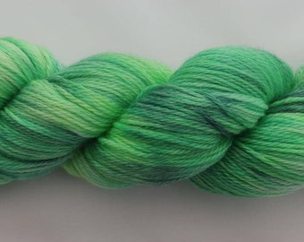 A Luxuriously soft Hand dyed 4ply Yarn on a Super Wash Merino, Tencel base in the Bright Blast - Green colourway. A blend of vibrant greens.