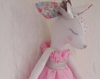 White linen doll and pink feather