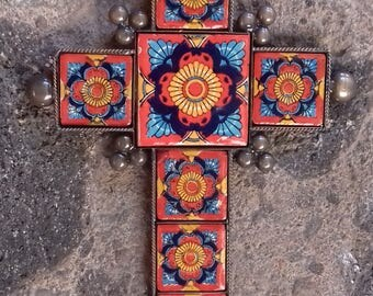 Vintage look cross traditional Mexican teracota and blue design ceramic tile in a metal setting rustic design southwest decor