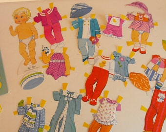 1975 Baby Alive Paper Doll with Paper Carrying Basket   (867)