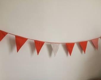 Warm, cozy, orange flags line