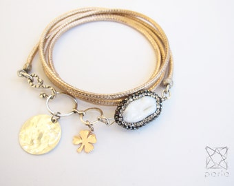 PURE BEAUTY BRACELET with genuine leather wrap, freshwater Pearl and charms.