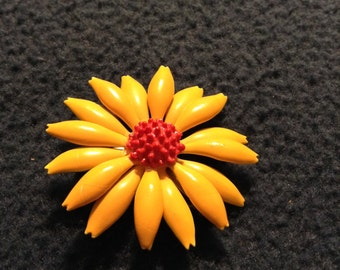 Vintage yellow orange daisy flower brooch pin with red center.