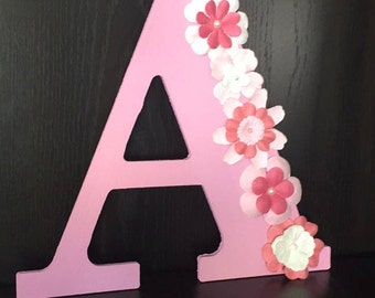 Initial letter with flower accents