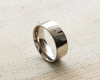 A handmade 18ct white gold ring wide wedding ring with a flat modern outside profile and comfort curve on the inside