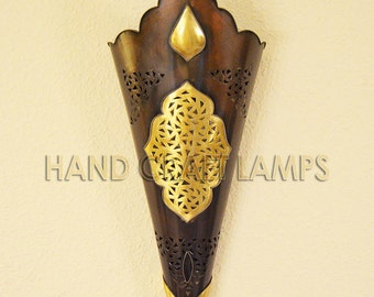 Large torch-shape wall sconce of brass