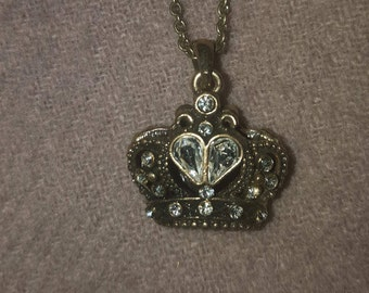 Gold chain with a crown pendant