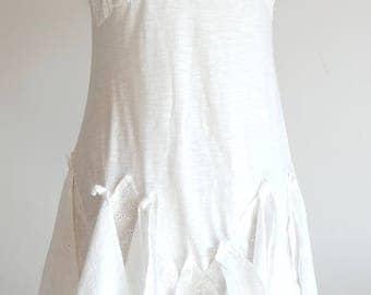 Cotton jersey dress and sangallo inspiration twenties, all cut edges.