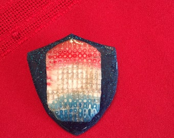 Red White and Blue on a Navy Shield Background