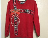 Red Ugly sweater. Big Bow sweater. hand knit sweater. marissa christina classics. christmas present sweater