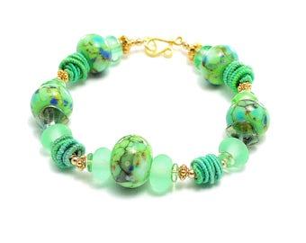 Irish Green Lampwork Bead Bracelet. Spring Summer Glass Bead Bracelet. Artisan Fiber Bead Bracelet. Bali Beads. Glass Bead Jewelry.