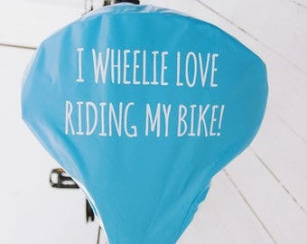 I Wheelie Love Riding My Bike | Bike Seat Cover | Cyclist Gift | Gift For Bike Lovers | Waterproof Saddle Cover