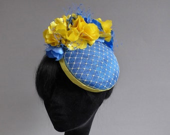 Dutch design aqua and yellow sinamay hat with ton sur ton veiling and flowers on comb