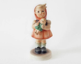 Vintage Singing Girl Holding a Doll Figurine by Goebel