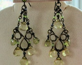 Dangle earings with crystals that look yellow but are really very light green and a green rhinestone elegant