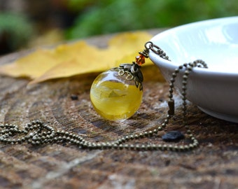 Sunflower Petals Orb Resin Pendant with Antiqued Bronze Metal