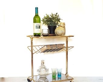 SOLD Mid Century Gold Side Table / Rolling Glass Cart / Magazine Rack ~ Bar Cart / Vintage Three Tier Smoke Glass and Gold Tone Table