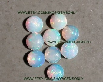 10mm NATURAL ETHIOPIAN OPAL round 10mm ethiopian round 10mm opal round best quality wholesell deal available text me i am a gemstone cutter