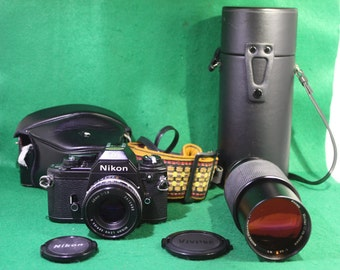 Nikon EM camera and 50 mm and  Vivitar 75-205 mm lens bundle