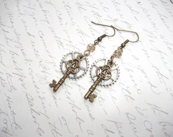 Steampunk style earrings with key and gears in antique bronze and silver