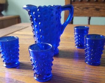 Miniature glass pitcher, hobnail,four cups