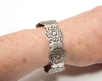 Antique silver Moroccan rose and sun bangle