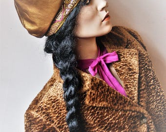 Unique soft goldtone lamb leather hat with embroided/beaded band