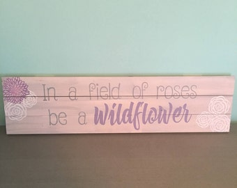 In a field of roses be a wildflower Wall Decor