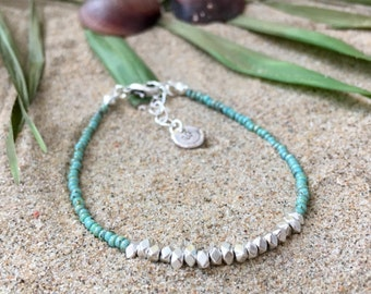Ocean shimmers bracelet - Turquoise picasso seed beaded bracelet with silvertone faceted beads