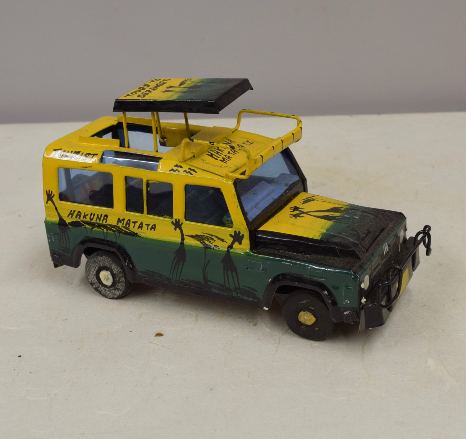 Truck African Safari Recycled Yellow Tin Truck Pop Up Roof ...