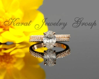 8x6mm Oval Forever One Moissanite and Diamond Solitaire Engagement Set in 14K Rose Gold (avail. white gold, yellow gold and platinum)