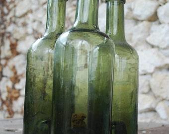 three antique french wine bottles