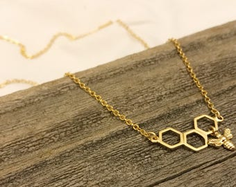 Gold honeycomb necklace with bee charm