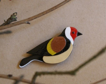 Made to order Goldfinch winter bird design brooch from polymer clay in the red, white, brown and black colors