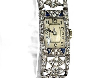 Platinum and gold watch 18K art deco 1930 decorated with sapphires and diamonds