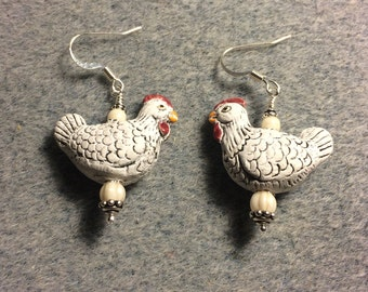 White ceramic chicken bead earrings adorned with white Czech glass beads.