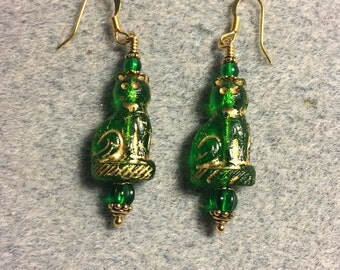 Emerald green fancy Czech glass cat bead earrings adorned with emerald green Czech glass beads.