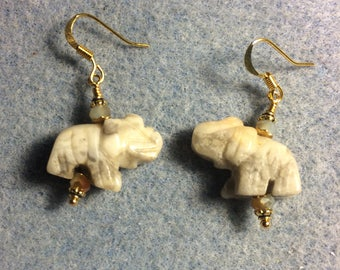 Off white yellow crazy agate gemstone elephant bead earrings adorned wirh tan Chinese crystal beads.